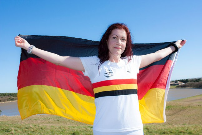 Jacqueline Prouse holds aloft the national flag of Germany