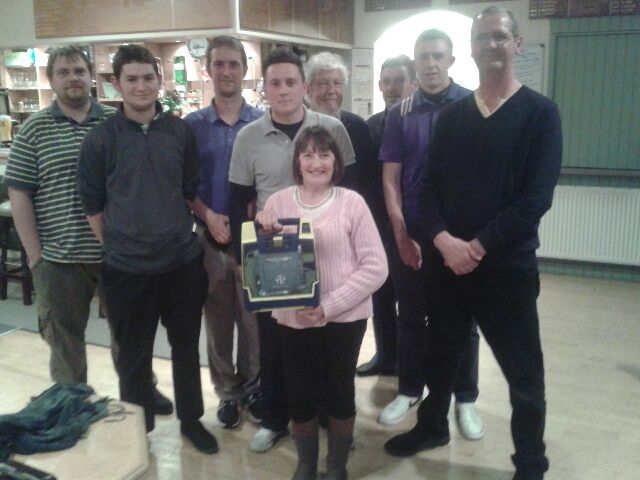 Pat Tatters with members of Wooler Golf Club and their new defibrillator.