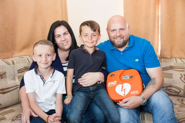 Cole Taylor with defibrillator donated by The Stephen Carey Fund