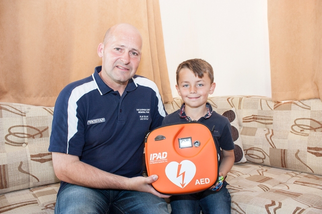 Cole Taylor receives defibrillator from The Stephen Carey Fund